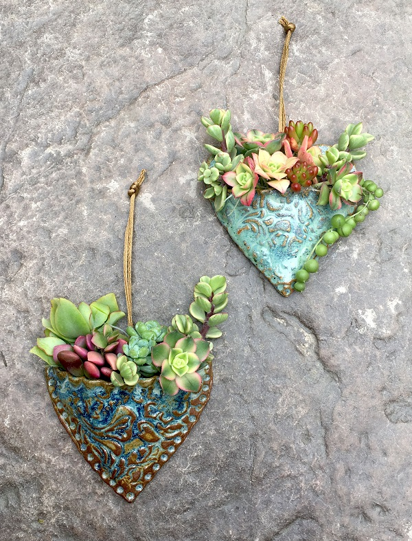 2 succulent hearts planted and ready to hang