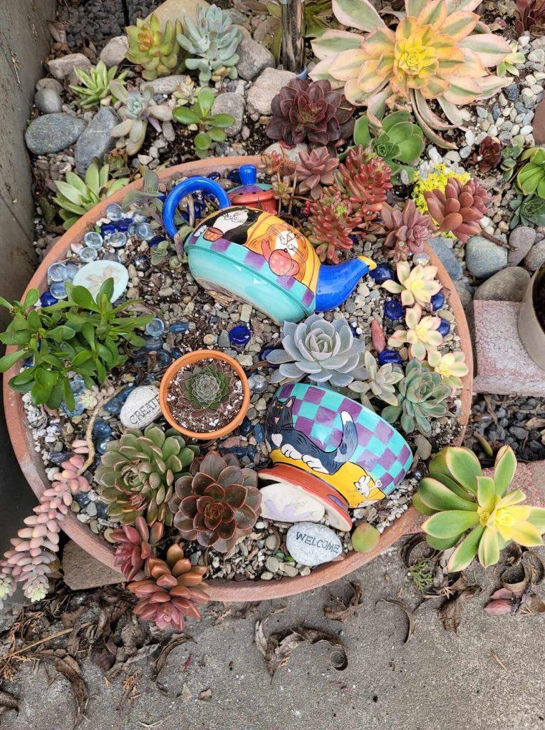 broken tea pot dresses up succulent planter